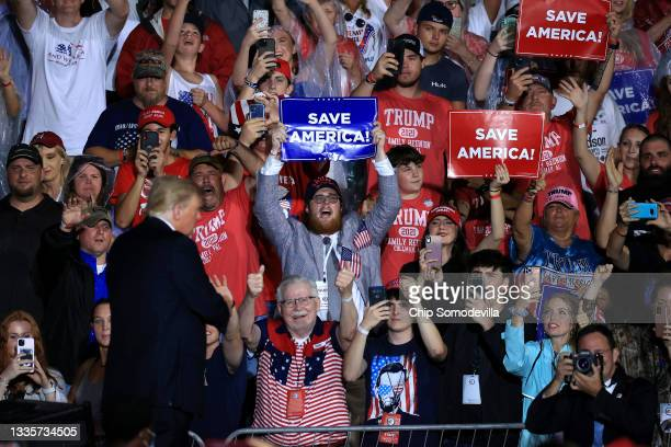 """Supporters cheer for former U.S. President Donald Trump as he finishes addressing a """"Save America"""" rally at York Family Farms on August 21, 2021 in..."""