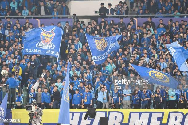 Supporters cheer for Jiangsu Suning during 2018 Ping An Chinese Football Association Super League second round match between Jiangsu Suning F.C. And...