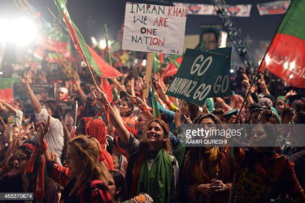 Supporters cheer for Pakistani cricketerturned politician Imran Khan during an antigovernment protest in front of the Parliament in Islamabad on...