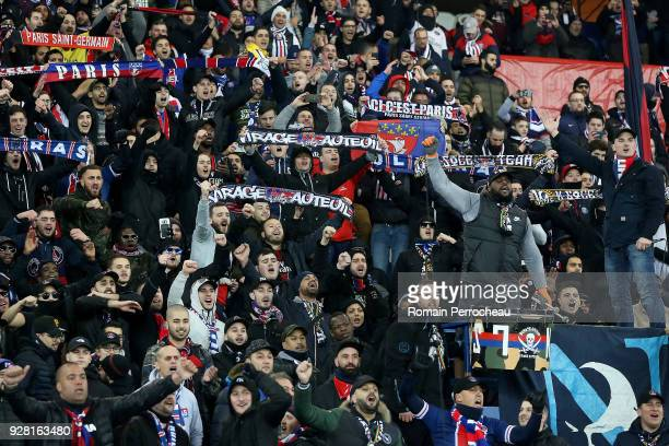 Supporters cheer for Paris Saint Germain before the UEFA Champions League Round of 16 Second Leg match between Paris SaintGermain and Real Madrid at...
