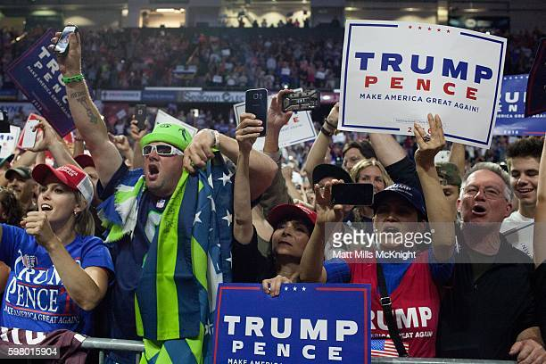 Supporters cheer for Republican presidential candidate Donald Trump during a campaign rally on August 30 2016 in Everett Washington Trump addressed...