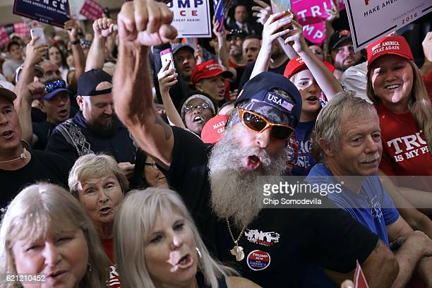 Supporters cheer for Republican presidential nominee Donald Trump during a campaign rally in the Special Events Center on the Florida State...