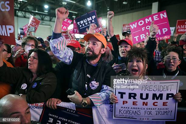 Supporters cheer for Republican presidential nominee Donald Trump during a campaign rally the RenoSparks Convention Center November 5 2016 in Reno...