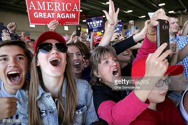 Supporters cheer for Republican presidential nominee Donald Trump during a campaign rally in the Sun Country Airlines Hangar at MinneapolisÐSaint...