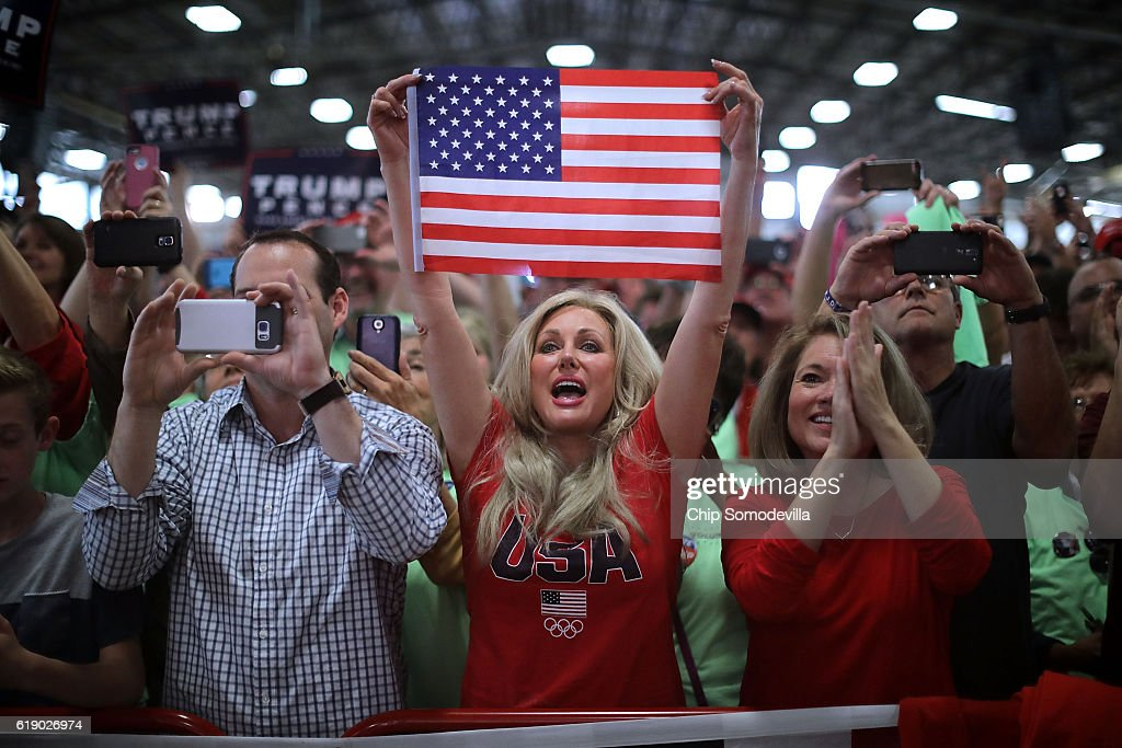 Supporters cheer for Republican presidential nominee Donald Trump as he arrives for a campaign rally in the Rodeo Arena at the Jefferson County Fairgrounds October 29, 2016 in Golden, Colorado. The Federal Bureau of Investigation announced Friday it discovered emails pertinent to the closed investigation of Democratic presidential nominee Hillary Clinton's private email server and are looking to see if they improperly contained classified information. Trump said 'I think it's the biggest story since Watergate.'