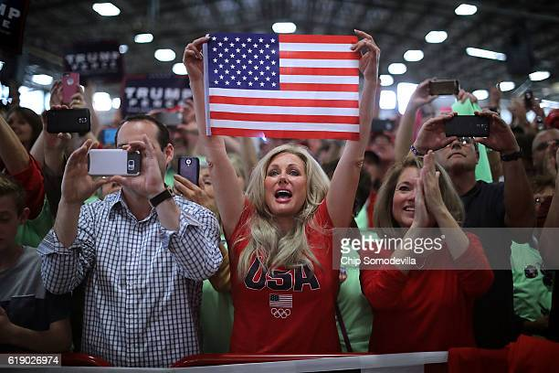 Supporters cheer for Republican presidential nominee Donald Trump as he arrives for a campaign rally in the Rodeo Arena at the Jefferson County...