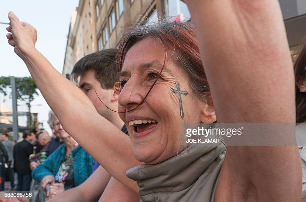 Supporters cheer for rightwing Austrian Freedom Party presidential candidate Norbert Hofer during Hofer's final election campaign rally at the Viktor...