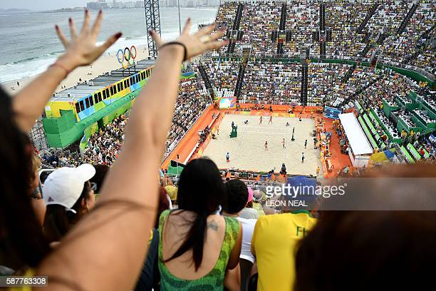 TOPSHOT Supporters cheer for their team during the women's beach volleyball qualifying match between Brazil and the USA at the Beach Volley Arena in...