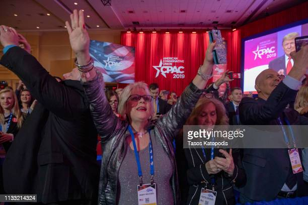 Supporters cheer for US President Donald Trump during CPAC 2019 on March 02 2019 in National Harbor Maryland The American Conservative Union hosts...