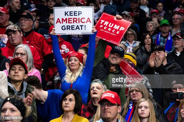 Supporters cheer in the crowd as President Donald Trump speaks at a Keep America Great campaign rally at the Huntington Center on January 9 2020 in...