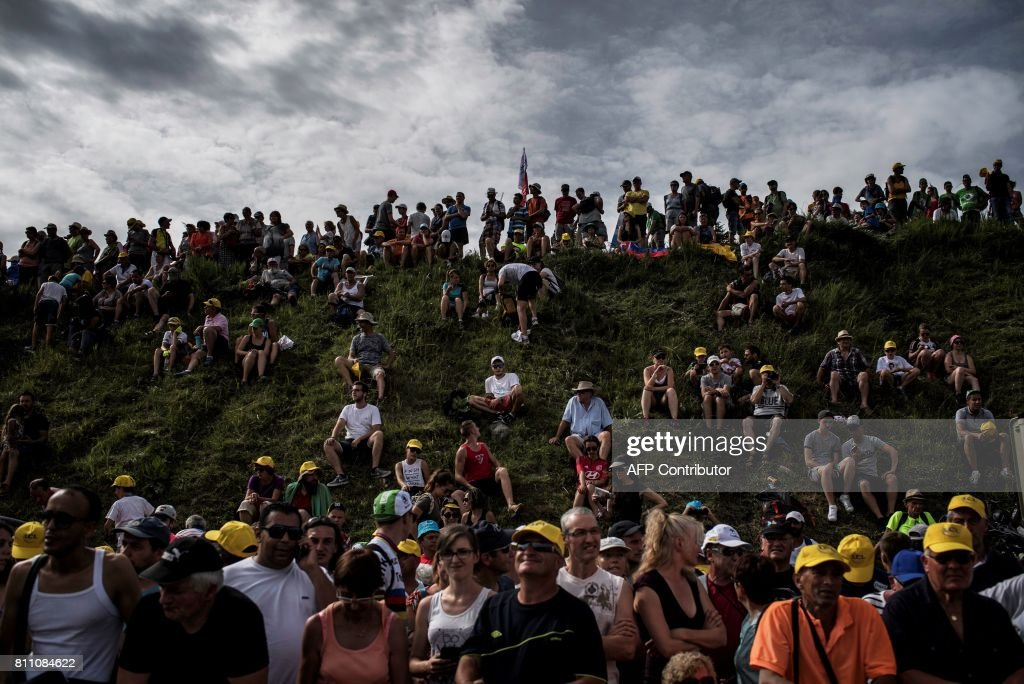 Supporters cheer near the finish line during the 187,5 km eighth stage of the 104th edition of the Tour de France cycling race on July 8, 2017 between Dole and Station des Rousses. / AFP PHOTO / Jeff PACHOUD