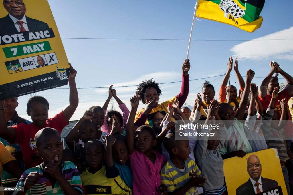 ANC supporters cheer on voters along the streets of Khayelitsha Township on May 7, 2014 in Cape Town, South Africa. Polls have opened in South Africa's fifth general election since the end of apartheid over 20 years ago. President Jacob Zuma is expected to return to power with the ANC party however his election campaign has been marred by allegations of corruption and he is expected to lose some ground to other parties.