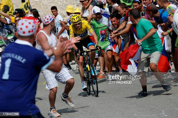 Supporters cheer overall leader's yellow jersey Britain's Christopher Froome during the 2425 km fifteenth stage of the 100th edition of the Tour de...