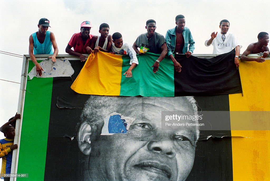 ANC supporters cheer President Nelson Mandela as his motorcade passes by during election campaign in Durban, South Africa : Stock Photo