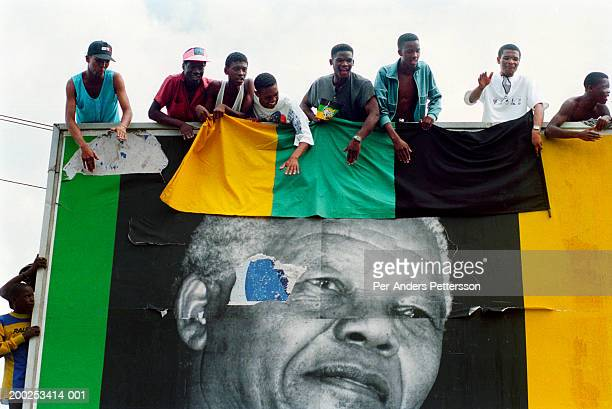ANC supporters cheer President Nelson Mandela as his motorcade passes by during election campaign in Durban, South Africa