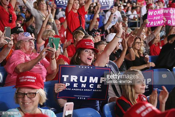 Supporters cheer Republican presidential nominee Donald Trump during a campaign event in Tampa Florida on October 24 2016 / AFP / Gregg Newton /...