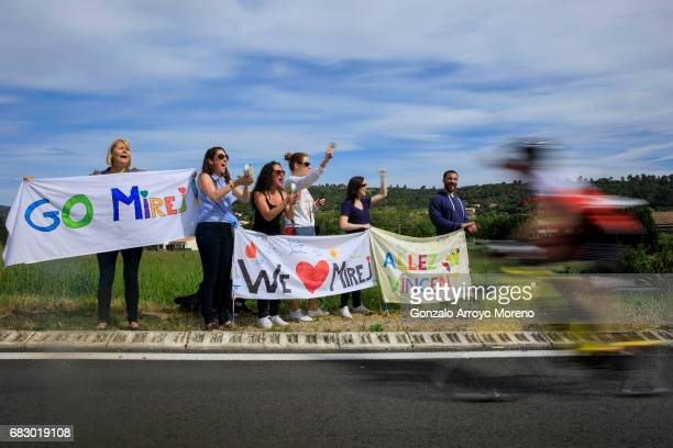 Supporters cheer their athletes as they compete during the biking course of the Ironman 703 Pays d'Aix on May 14 2017 in France