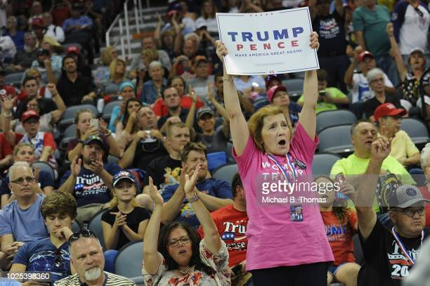 Supporters cheer U.S. President Donald Trump at a campaign rally at the Ford Center on August 30, 2018 in Evansville, Indiana. The president was in...
