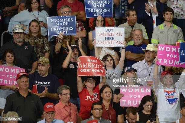 Supporters cheer US President Donald Trump at a campaign rally at the Ford Center on August 30 2018 in Evansville Indiana The president was in town...