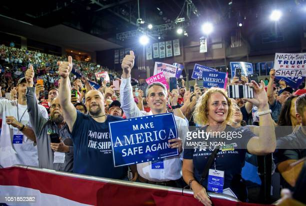 Supporters cheer US President Donald Trump during a Make America Great Again rally at Erie Insurance Arena on October 10 in Erie Pennsylvania
