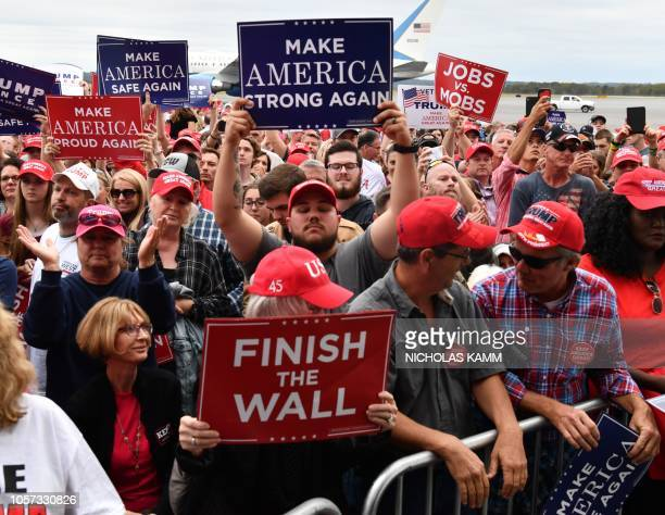 Supporters cheer US President Donald Trump during a Make America Great Again campaign rally at Middle Georgia Regional Airport on November 4 2018 in...