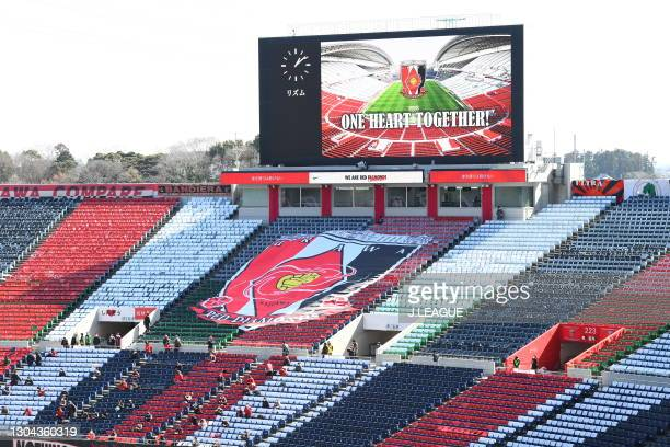 Supporters cheer with keeping social distances the J.League Meiji Yasuda J1 match between Urawa Red Diamonds and FC Tokyo at the Saitama Stadium on...
