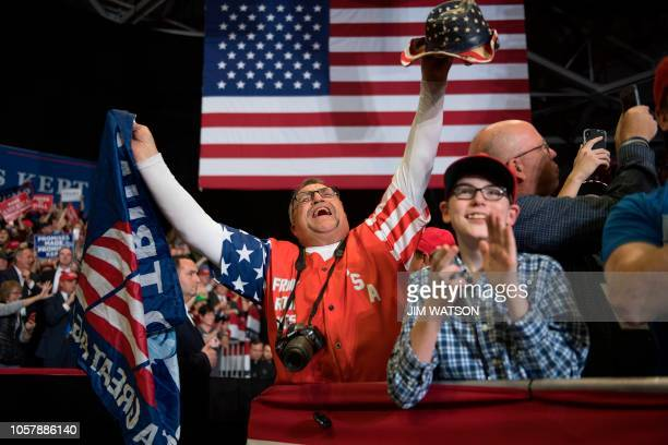TOPSHOT Supporters cheers as US President Donald Trump arrives at a Make America Great Again rally in Cape Girardeau Missouri on November 5 2018