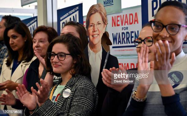 Supporters cheers with a cardboard cutout of Democratic presidential candidate Sen Elizabeth Warren during at a canvass kickoff event at a campaign...