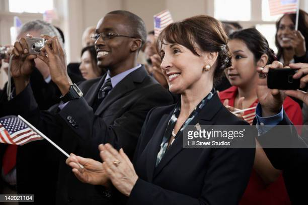 supporters clapping at political gathering - lapel stock pictures, royalty-free photos & images