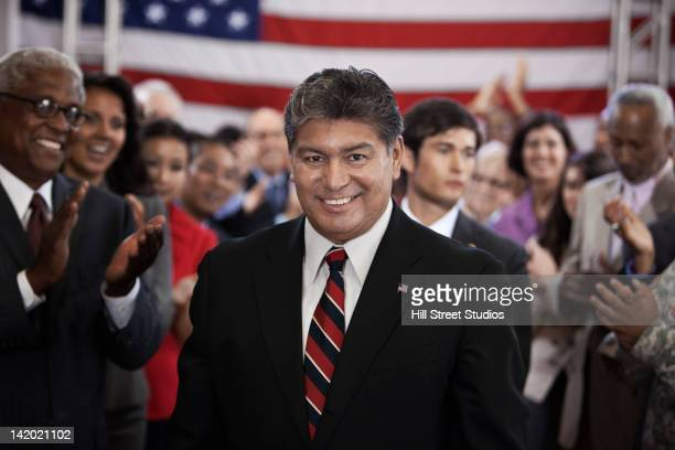 supporters clapping for politician - politician stock pictures, royalty-free photos & images