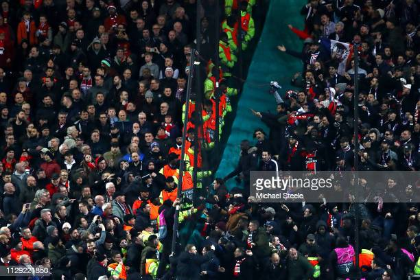 PSG supporters clash with those of Manchester United after they score their second goal during the UEFA Champions League Round of 16 First Leg match...