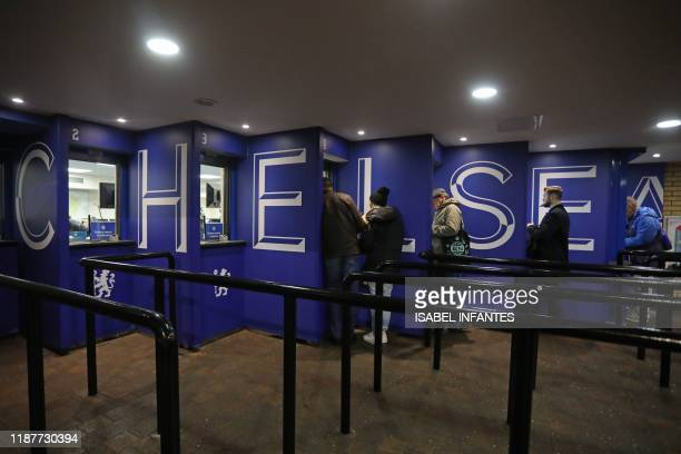 Supporters collect tickets ahead of the UEFA Champion's League Group H football match between Chelsea and Lille at Stamford Bridge in London on...