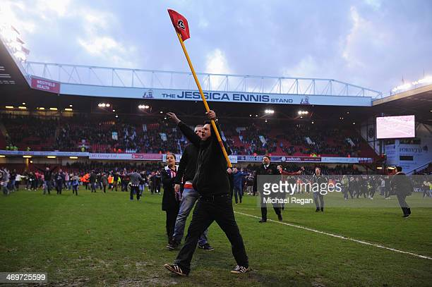 Supporters come onto the pitch at the end of the FA Cup Fifth Round match between Sheffield United and Nottingham Forest at Bramall Lane on February...