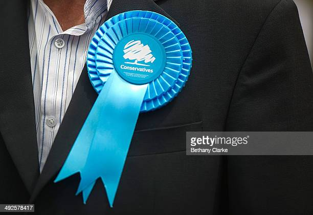 Supporter's Conservative rosette on May 21, 2014 in Ealing, England. The rally comes in the final day of campaigning before polls open for the...