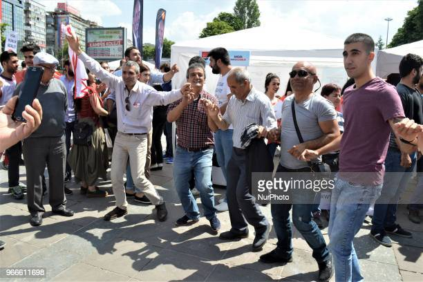 Supporters dance ahead of a march staged by the main opposition Republican People's Party for the early presidential and parliamentary elections in...
