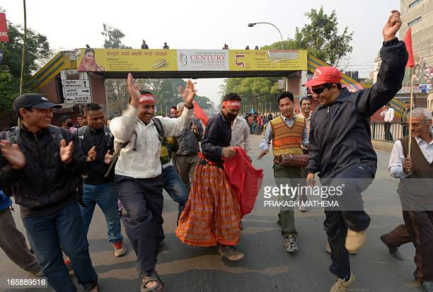 Supporters dance during a general strike called by the Communist Party of NepalMaoist in Kathmandu on April 7 2013 Nepal police arrested protesters...