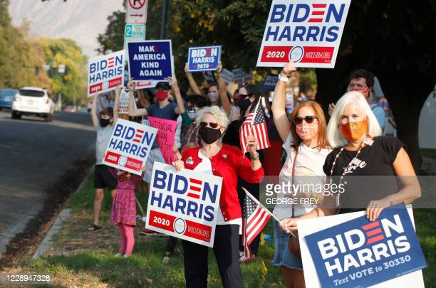 Supporters Democratic Presidential candidate and former US Vice President Joe Biden show their support before the vice presidential debate outside...