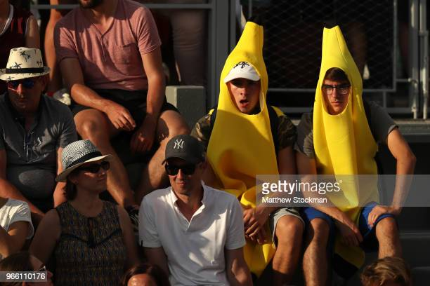 Supporters dressed as bananas watch on during the mens singles third round match between John Isner of The United States and PierreHugues Herbert of...