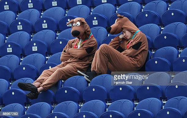 Supporters dressed as ScoobyDoo rest during a rain delay on day three of the npower 1st Ashes Test Match between England and Australia at the SWALEC...