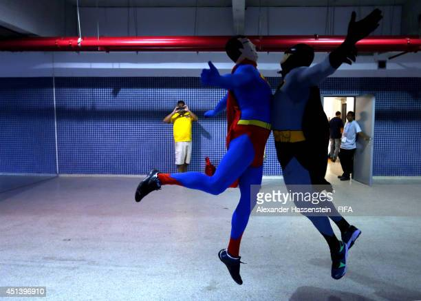 Supporters dressed as Superman and Batman celebrate at the stadium arena during the 2014 FIFA World Cup Brazil round of 16 match between Colombia and...