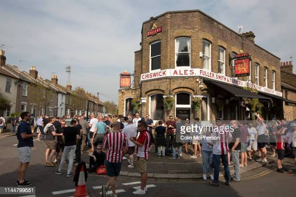 Supporters drinking outside the Griffin pub before Brentford hosted Leeds United in an EFL Championship match at Griffin Park Formed in 1889...