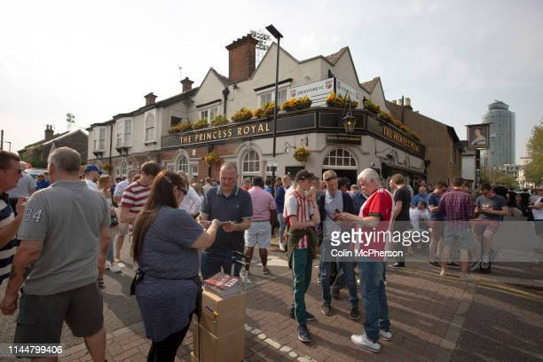 Supporters drinking outside the Princess Royal pub before Brentford hosted Leeds United in an EFL Championship match at Griffin Park Formed in 1889...