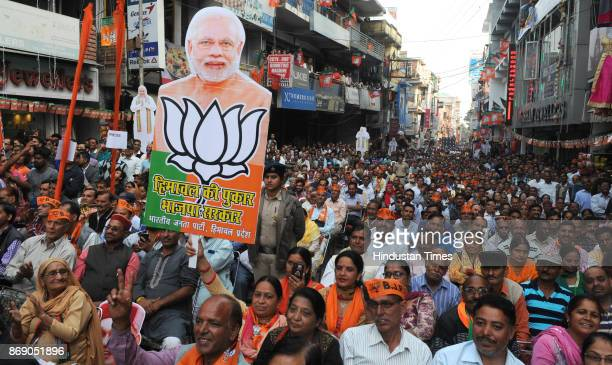 BJP supporters during an election rally for Hamirpur Vidhan Sabha at Gandhi Chowk in on November 1 2017 in Hamirpur India