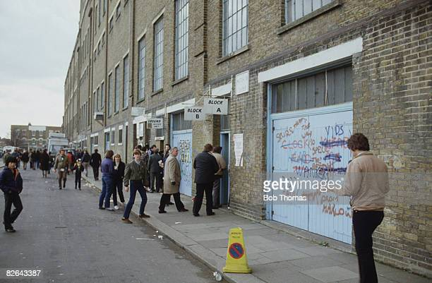 Supporters enter the East Terrace of Tottenham Hotspur's White Hart Lane stadium London 6th February 1982 The day's fixture was against Wolves Spurs...