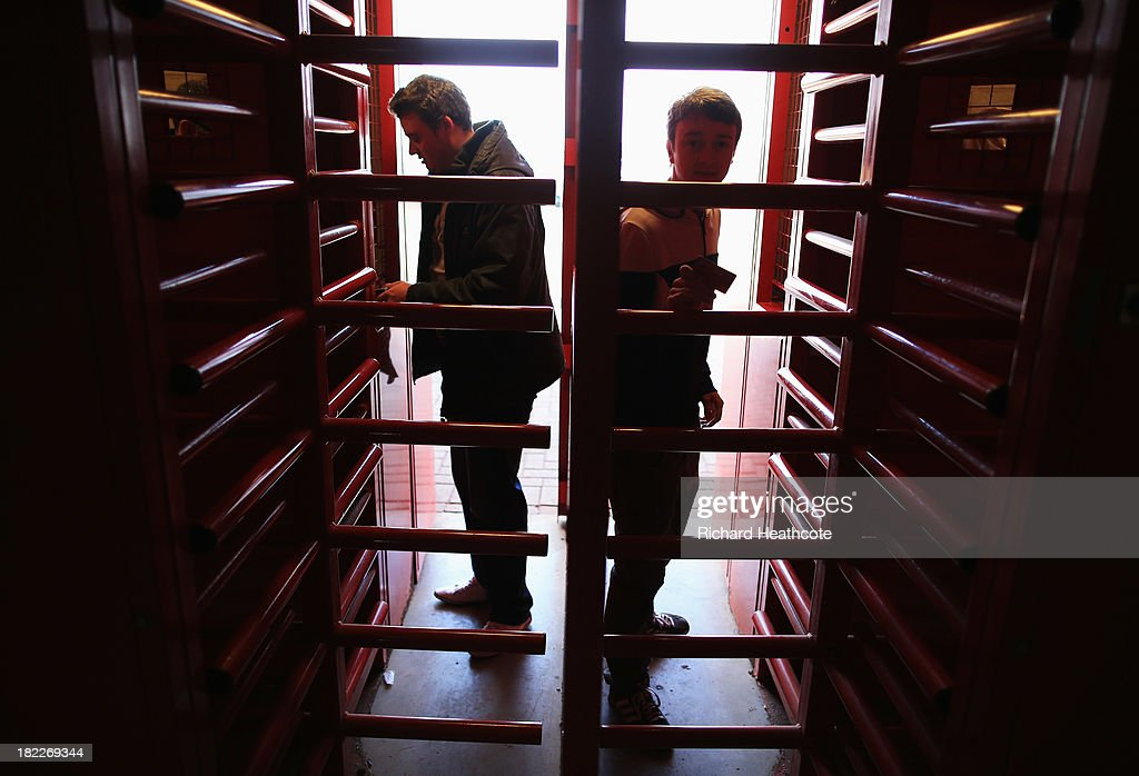 Supporters enter the ground through the turnstiles prior to the Barclays Premier League match between Stoke City and Norwich City at the Britannia Stadium on September 29, 2013 in Stoke on Trent, England.