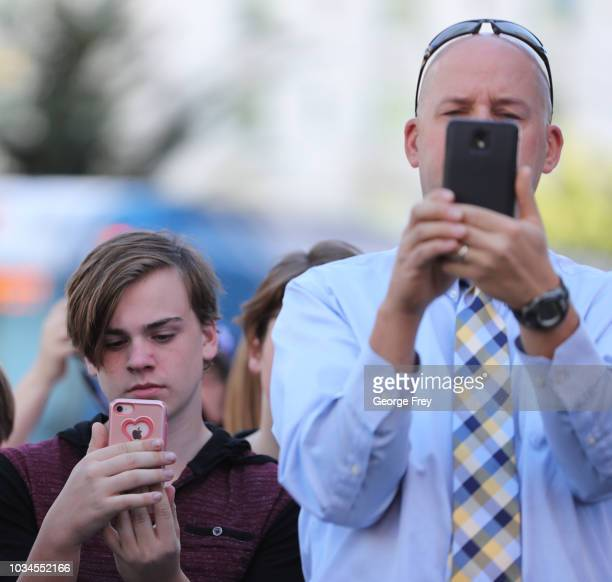 Supporters film Sam Young a former Mormon bishop and founder of Protect the Children as he reads a letter that informed him that he had been...