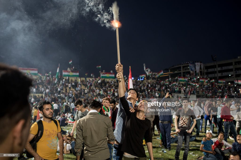 Supporters fire off fireworks inside the Erbil Stadium after hearing Kurdish President Masoud Barzani speak during a rally for the upcoming referendum for independence of Kurdistan on September 22, 2017 in Erbil, Iraq. The Kurdish Regional government is preparing to hold the September 25, independence referendum despite strong objection from neighboring countries and the Iraqi government, which voted Tuesday to reject Kurdistan's referendum and authorized the Prime Minister Haider al-Abadi to take measures against the vote. Despite the mounting pressures Kurdistan President Masoud Barzani continues to campaign and state his determination to go ahead with the vote.