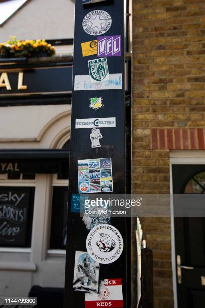 Supporters football stickers attached to a lamppost on Ealing Road outside the Princess Royal pub before Brentford hosted Leeds United in an EFL...