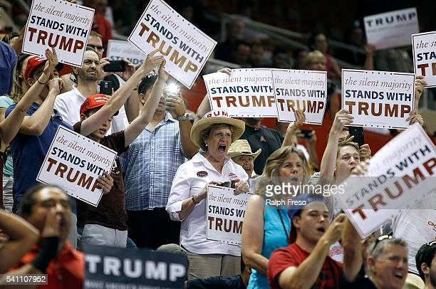 Supporters for Republican presidential candidate Donald Trump cheer as Trump arrives at a campaign rally on June 18 2016 in Phoenix Arizona Trump...