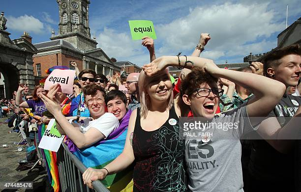 Supporters for samesex marriage raise a cheer at Dublin Castle as they wait for the result of the referendum on May 23 2015 Yes voters were basking...